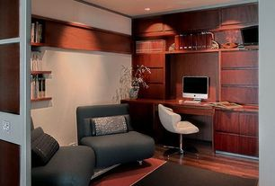 Contemporary Home Office with specialty door, Standard height, can lights, Laminate floors, Built-in bookshelf
