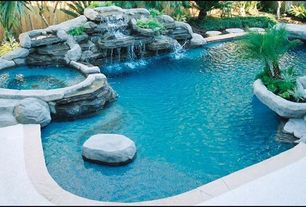 Rustic Swimming Pool with Viking Free Form Pools, Pool with hot tub, Pathway, Fence, Raised beds, exterior tile floors
