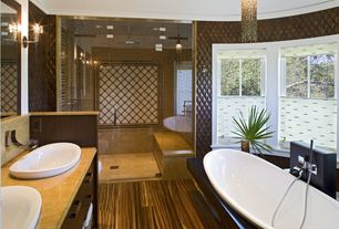 Contemporary Master Bathroom with Rain shower, Laminate floors, Master bathroom, Complex Marble, Zebrawood Wood Flooring