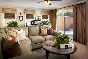 Traditional Living Room with sliding glass door, Carpet, Pottery barn dupioni silk drape, Wall sconce, Crown molding, Paint 1