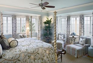 Traditional Master Bedroom with Ceiling fan, can lights, specialty window, Crown molding, Standard height, Hardwood floors