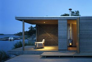 Contemporary Deck with Reclaimed wood siding, Freestanding fireplace, Outdoor armchair