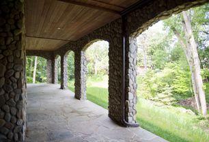 Mediterranean Porch with exterior stone floors, Wrap around porch