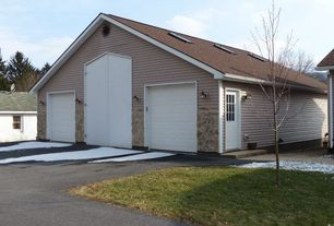 Traditional Garage with Standard height, six panel door, Wall sconce, Concrete floors