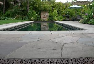Traditional Swimming Pool with Lap pool, exterior tile floors, exterior stone floors, exterior concrete tile floors