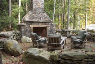 Country Patio with exterior stone floors, stone fireplace, Outdoor seating area, Natural stone retaining wall