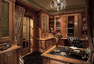Traditional Home Office with Tufted leather executive chair, Custom cabinetry - golden oak, Carpet, Chandelier, French doors