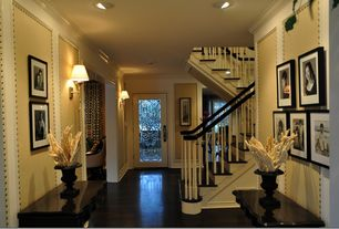 Eclectic Entryway with Nail stud wall panel, Wood staircase, Hall table, Wall sconce, Crown molding, Hardwood floors