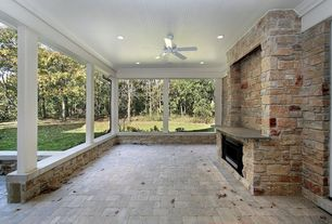 Contemporary Porch with exterior stone floors, stone fireplace, Wrap around porch, Ceiling fan, Wood column, Wood ceiling