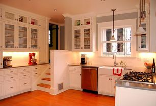 Modern Kitchen with Crown molding, Hardwood floors, Beadboard backsplash, Glass panel inserts, Paint, Glass front cabinets
