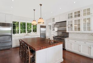 Traditional Kitchen with gas range, Cup cabinet pulls, Carrara white marble, Glass panel cabinets, Marble backsplash