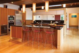Contemporary Kitchen with Cylinder Wood Cage Shade Home Pendant Light, Corian Solid Surface Countertop in Deep Nocturne