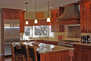 Traditional Kitchen with Pendant light, Limestone Tile, Custom hood, L-shaped, Kitchen island, Undermount sink, Raised panel