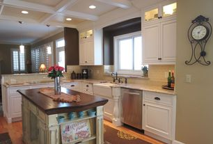 Traditional Kitchen with Raised panel, L-shaped, Kitchen island, Wood counters, Pendant light, Farmhouse sink, Crown molding