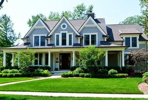 Traditional Exterior of Home with Architectural collumns, Lush lawn