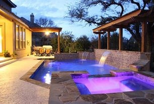Contemporary Swimming Pool with Pool with hot tub, Outdoor kitchen, double-hung window, Trellis, exterior stone floors, Fence