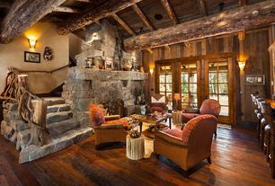 Rustic Living Room with Round rustic stick stool, Wood panel wall, Eldorado Stone Moonlight RoughCut, Hand-Hewn Oak