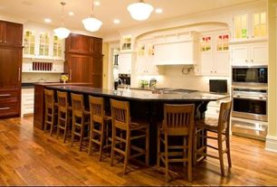 Traditional Kitchen with Custom hood, L-shaped, Pendant light, Crown molding, Flat panel cabinets, Glass Tile, Glass panel