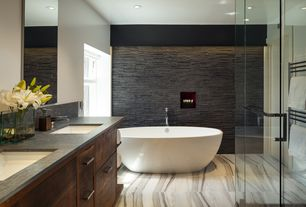 Contemporary Master Bathroom with Undermount sink, Double sink, Flat panel cabinets, complex granite floors, Flush