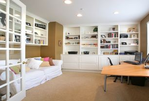 Traditional Home Office with Sofa, Paint 1, Capet, Built-in bookshelf, recessed lights, Melamine desk, can lights, Paint 2