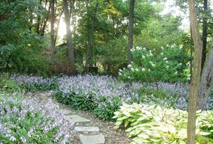 Traditional Exterior of Home with Stone walkway, Hosta plant, Private backyard