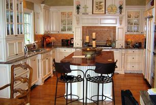 Traditional Kitchen with Copper counters, Casement, Limestone Tile, Built In Panel Ready Refrigerator, Framed Partial Panel