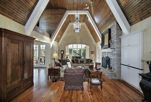 Traditional Great Room with Hardwood floors, High ceiling, flush light, Exposed beam, French doors