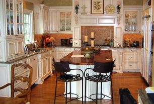 Traditional Kitchen with Stone Tile, Raised panel, Undermount sink, Copper counters, Kitchen island, U-shaped, Custom hood