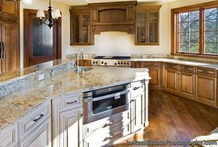 Traditional Kitchen with Pendant light, Kitchen island, Simple Granite, Glass panel, Custom hood, Undermount sink, One-wall
