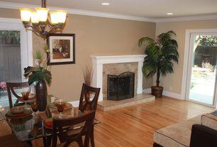 Modern Living Room with Standard height, sliding glass door, brick fireplace, Chandelier, Crown molding, Laminate floors