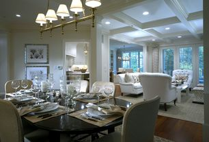 Traditional Dining Room with Hardwood floors, Box ceiling, Columns, flush light