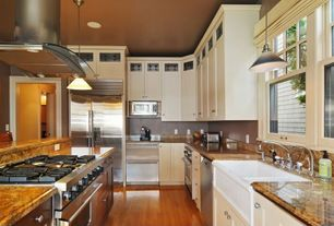Traditional Kitchen with gas range, Simple Granite, Kitchen island, dishwasher, Framed Partial Panel, Farmhouse sink