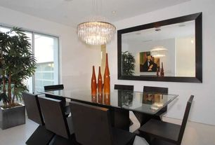 Contemporary Dining Room with Chandelier, Concrete floors