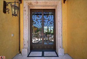 Mediterranean Front Door with exterior tile floors, French doors