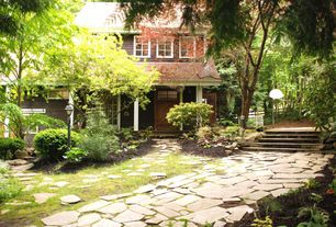 Traditional Landscape/Yard with Fence, Casement, Glass panel door, exterior stone floors, picture window