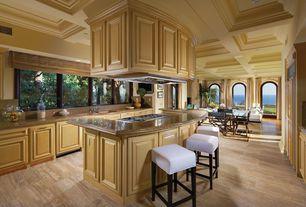 Traditional Kitchen with travertine tile floors, Island Hood, Built In Panel Ready Refrigerator, full backsplash, U-shaped