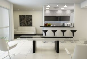 Contemporary Dining Room with simple marble tile floors, flush light