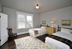 Eclectic Guest Bedroom with six panel door, double-hung window, flush light, Standard height, Hardwood floors