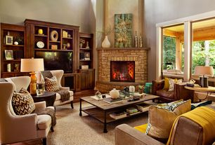 Modern Living Room with Built-in bookshelf, Arteriors home colby waxed wood table lamp, Hardwood floors, stone fireplace