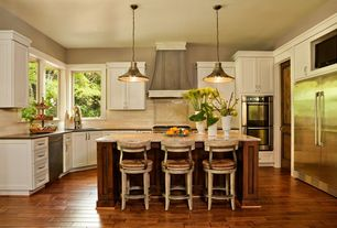 Traditional Kitchen with Breakfast bar, Custom hood, Simple granite counters, Flat panel cabinets, Kitchen island, Stone Tile