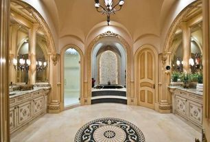 Traditional Master Bathroom with Custom casework, Complex tile inlay, Inset bathtub, Chandelier, Archways, Interior pilaster