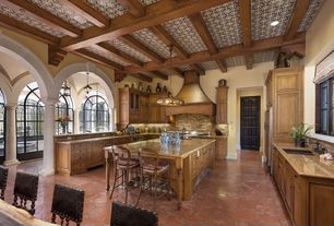 Mediterranean Kitchen with Breakfast bar, specialty door, Smith & noble flat roman fabric shades, Arched window, Custom hood