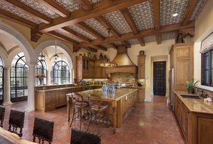Mediterranean Kitchen with full backsplash, Simple granite counters, Smith & noble flat roman fabric shades, Kitchen island