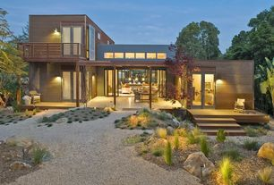 Contemporary Exterior of Home with Gravel landscape, Indoor/outdoor living, Pathway, French doors