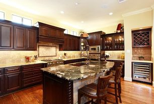 Traditional Kitchen with Kitchen island, Raised panel, L-shaped, Custom hood, Hardwood floors, Complex granite counters