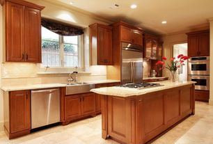 Traditional Kitchen with Glass Tile, Raised panel, Kitchen island, specialty door, limestone floors, L-shaped, Glass panel