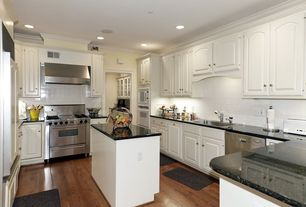 Traditional Kitchen with Raised panel, Large Ceramic Tile, Hardwood floors, Kitchen island, Simple granite counters, L-shaped