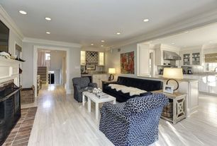 Contemporary Great Room with Crown molding, Laminate floors