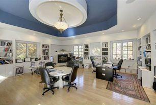 Traditional Home Office with flush light, Hardwood floors, stone fireplace, Built-in bookshelf