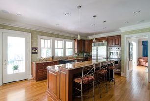 Traditional Kitchen with Pendant light, Simple granite counters, Raised panel, full backsplash, can lights, Standard height